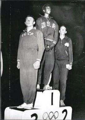 Gold medallist Charles Dumas, silver medallist Chilla Porter and bronze medallist Ivor Kashkaro