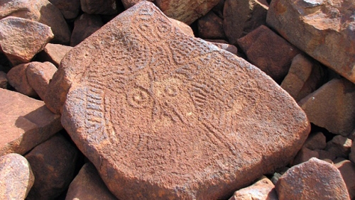 This Burrup petroglyph may be one of the oldest carved faces in the world. (Credit: Ken Mulvaney)